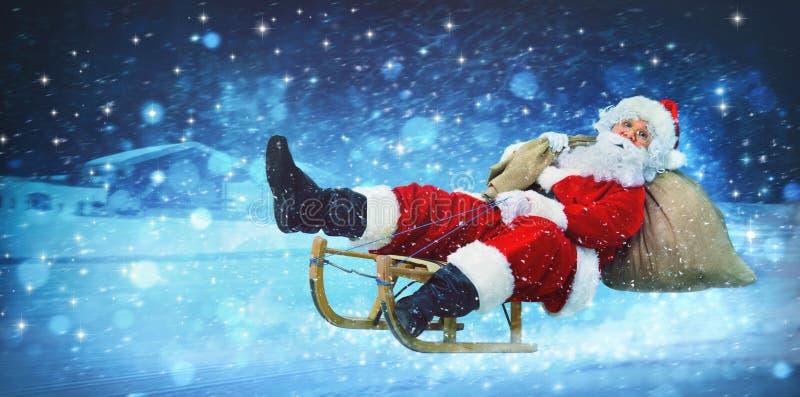 Santa Claus em seu pequeno trenó imagem de stock