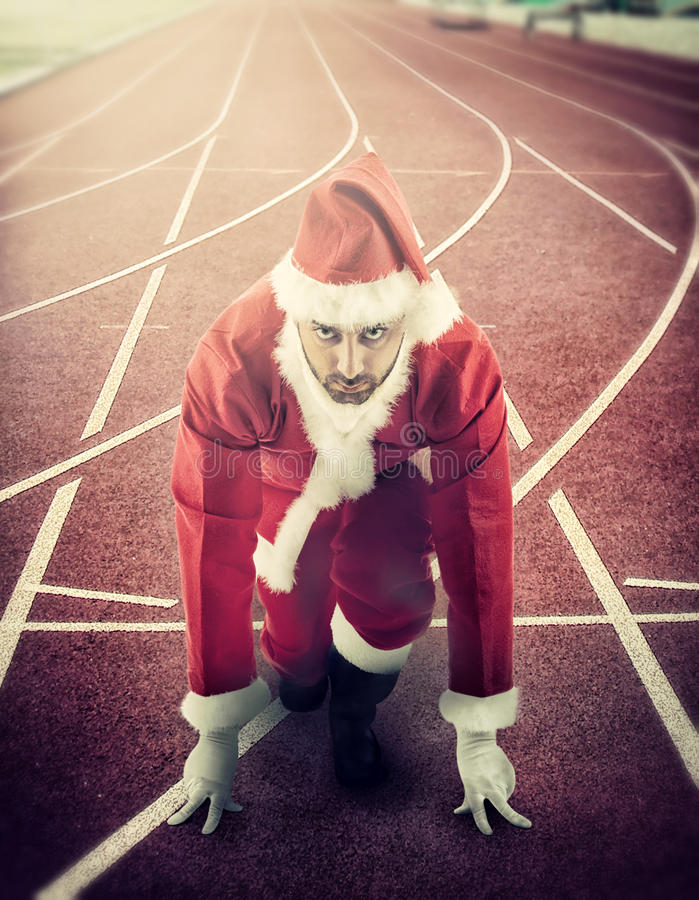 Santa Claus en la posición de salida respecto a una pista corriente imágenes de archivo libres de regalías
