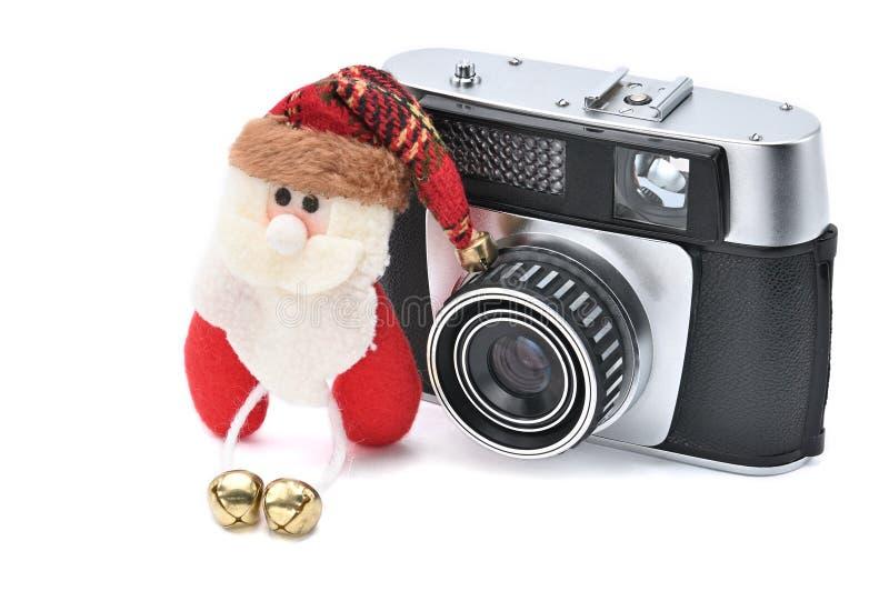 Santa Claus en uitstekende camera op een witte achtergrond voor het Nieuwjaar en Kerstmis stock afbeeldingen