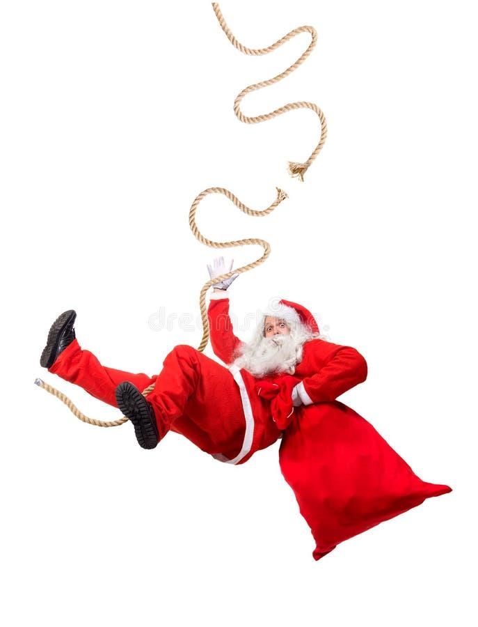 Santa Claus engraçada adere-se em uma corda quebrada fotografia de stock
