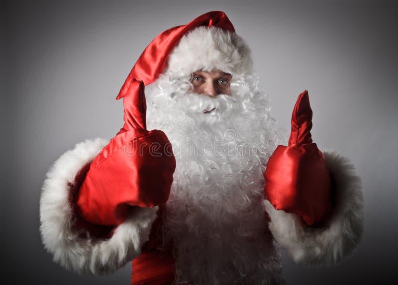 Santa Claus está mostrando os polegares acima fotografia de stock
