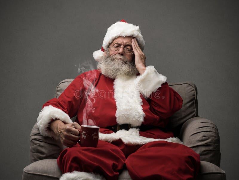 Santa Claus está tendo uma dor de cabeça fotografia de stock