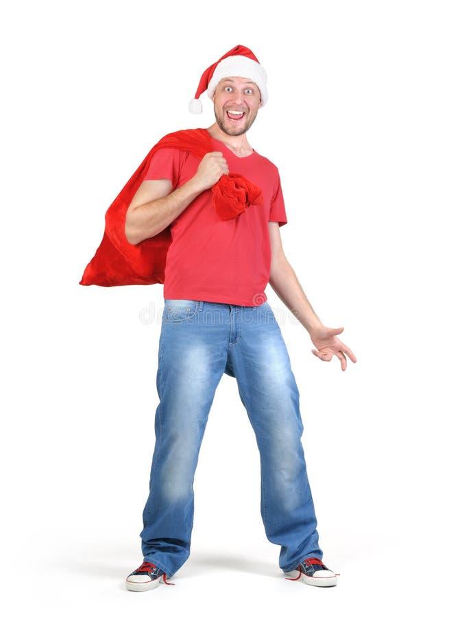 Santa Claus farpada engraçada com um saco vermelho dos presentes fotos de stock