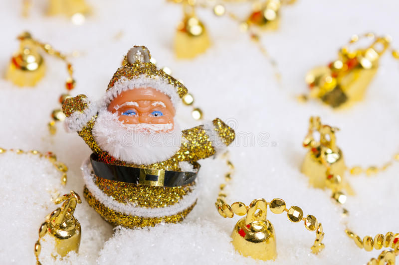 Santa Claus figurine and Christmas golden bells stock photo