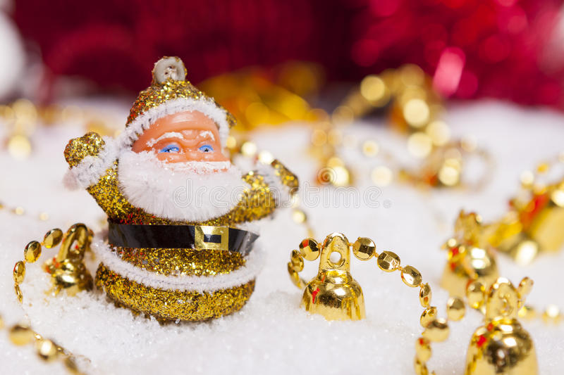 Santa Claus figurine and golden bells stock photography