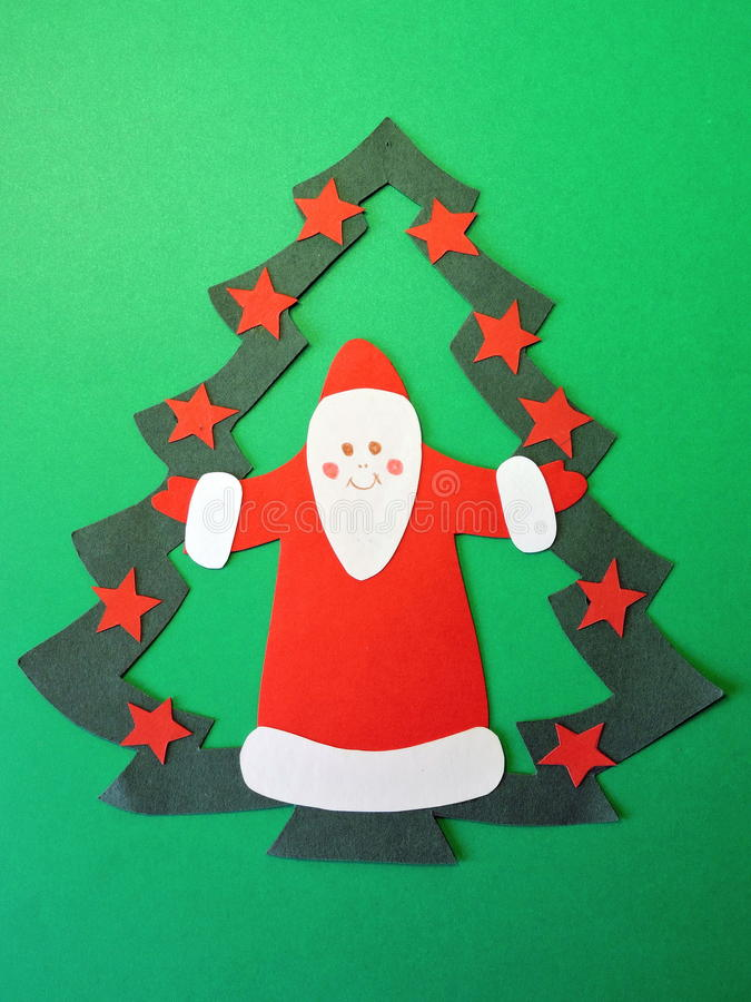 Santa Claus and fir tree. Paper cutting. stock image