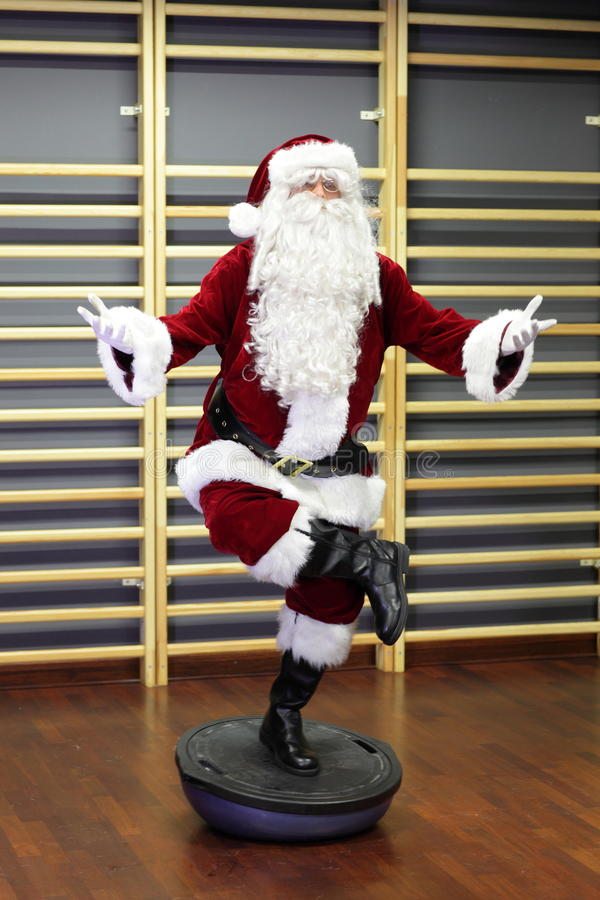 Santa Claus Fitness Training On Stablity Hemisphere Stock Photo