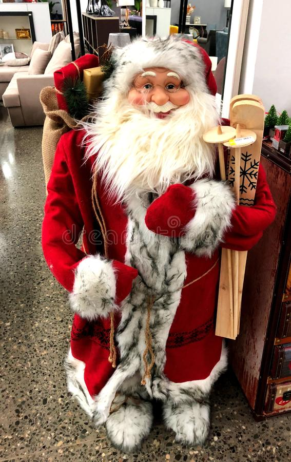 Santa Claus with funny smiles and skis. stock photos