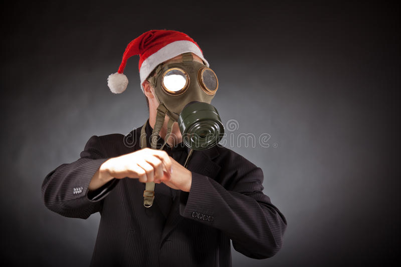 Santa claus with gas mask. In studio stock photography