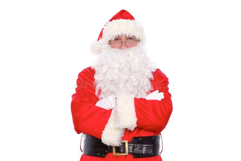 Santa Claus gentile che sta con le armi attraversate, isolate su fondo bianco fotografie stock libere da diritti