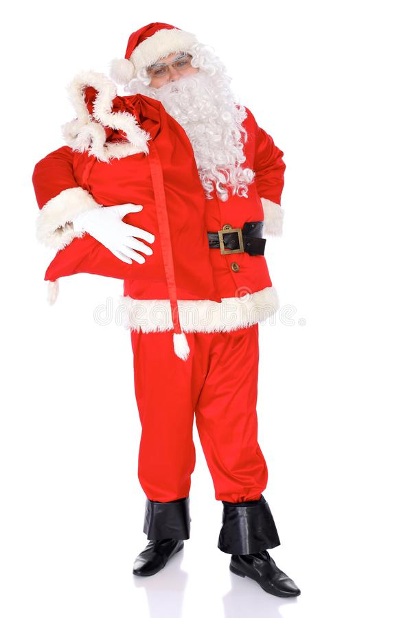 Santa Claus gesticulate while standing straight, isolated over white background. Winter Merry Christmas or New Year. Concept stock photography
