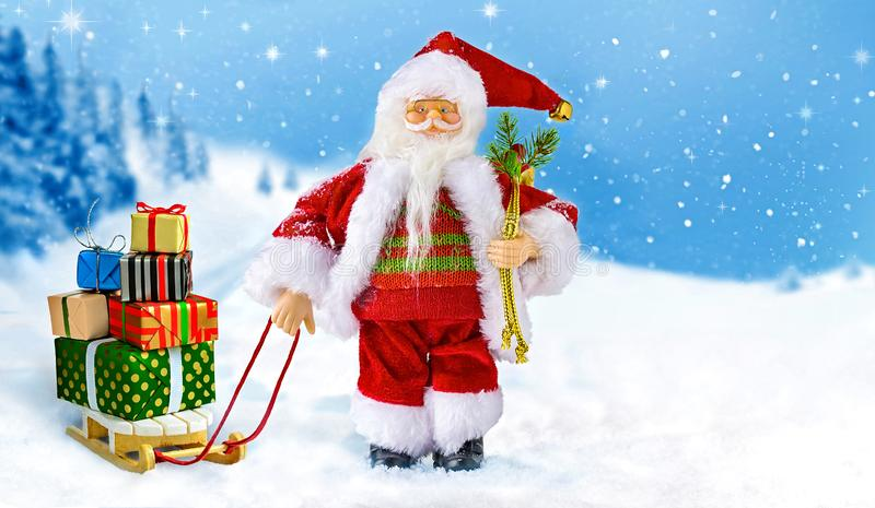 Santa Claus with gift boxes on the sleigh stock photo
