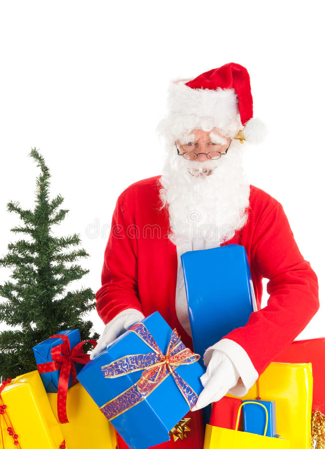 Santa Claus with gifts. Santa Claus with many presents and tree isolated over white background stock photo