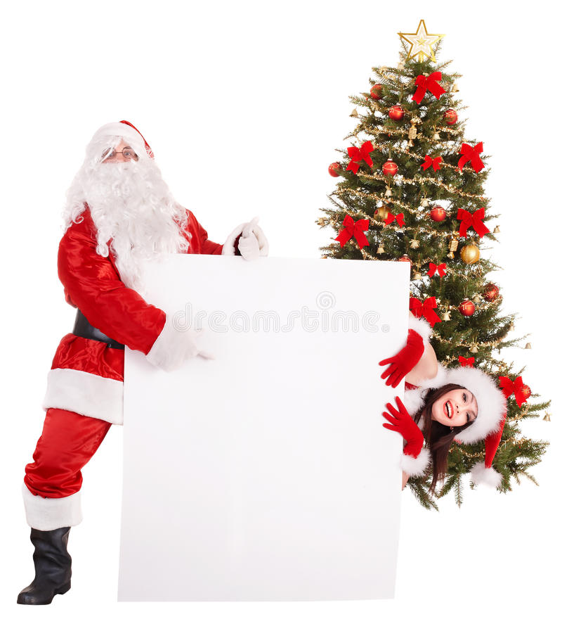 Santa claus and girl holding banner by christmas tree.. Isolated royalty free stock photography