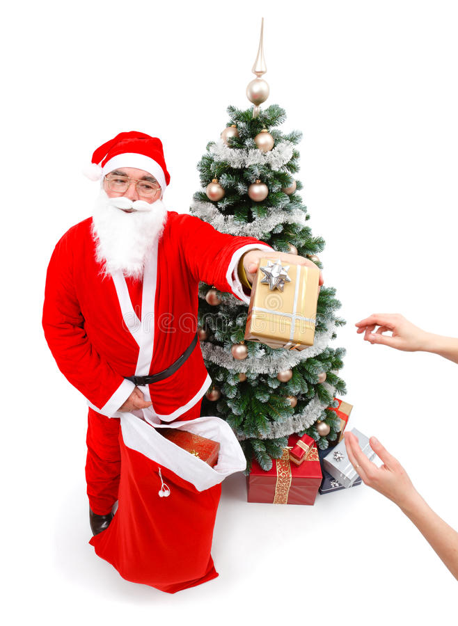 Download Santa Claus giving a gift stock image. Image of caucasian - 16847703