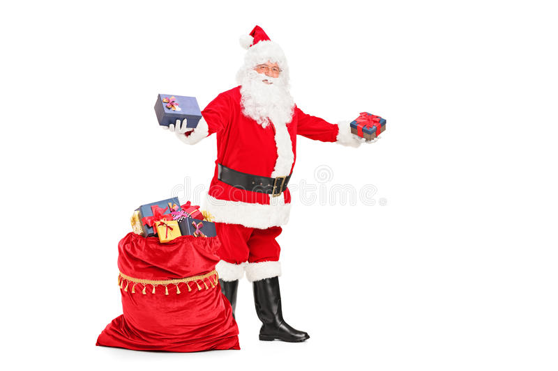Santa claus giving gifts and bag full of presents stock photo download santa claus giving gifts and bag full of presents stock photo image 27603650 negle