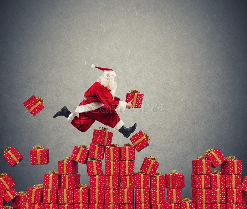 Santa Claus goes fast over Christmas gift stock photo