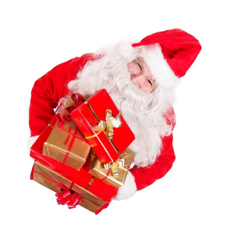Santa Claus hållande julgåvor royaltyfri foto