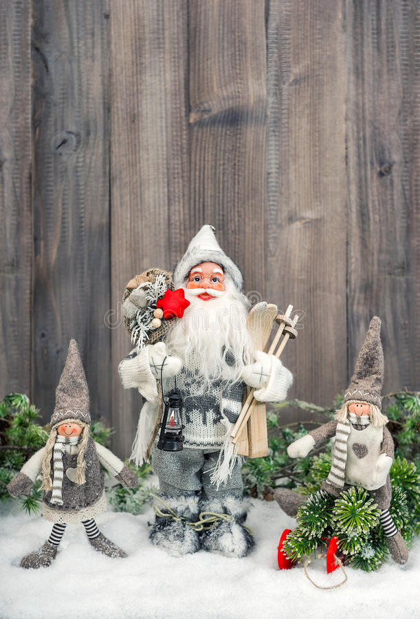 Santa Claus and happy kids in snow. Christmas decoration stock photography