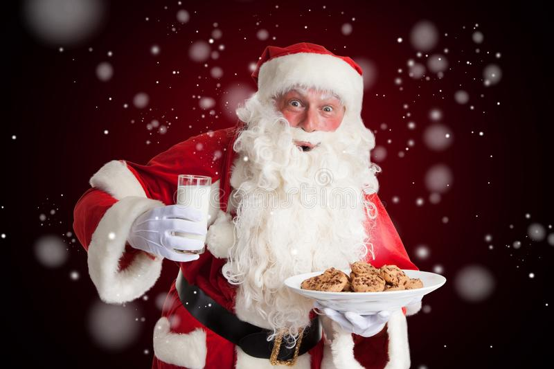 Santa Claus is happy about milk and cookies stock photography