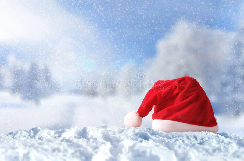 Santa Claus hat on snow at Christmas outside stock photography