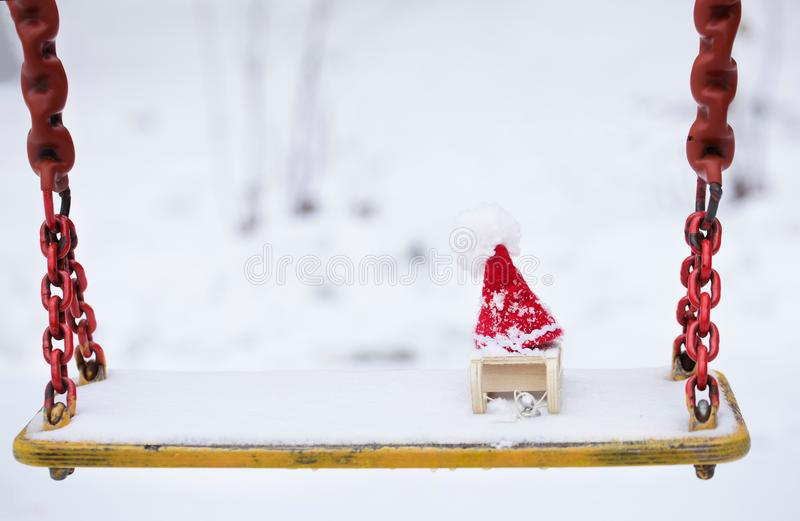 Santa Claus hat on a wooden made sleigh. Closeup royalty free stock images
