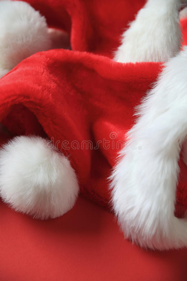 Santa Claus hats with copy space stock photo