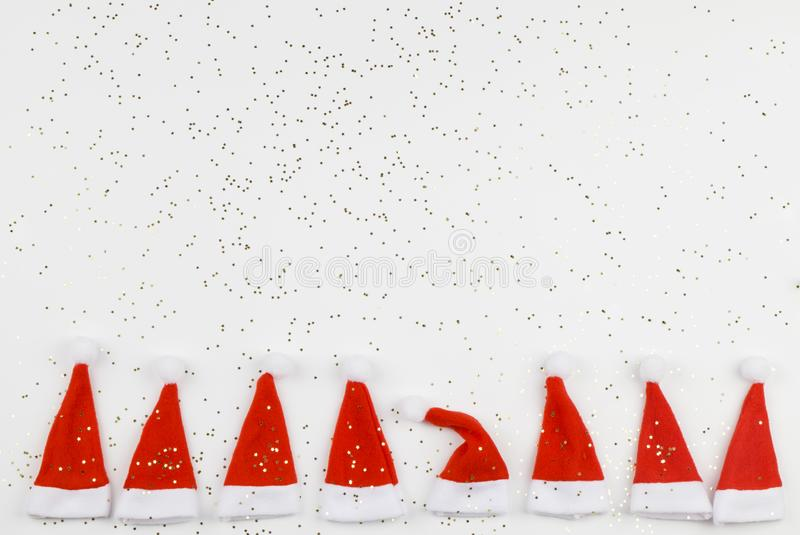 Santa Claus hats on white background with little stars. Christmas and New Year celebration. Christmas concept. Dissimilarity concept stock photo