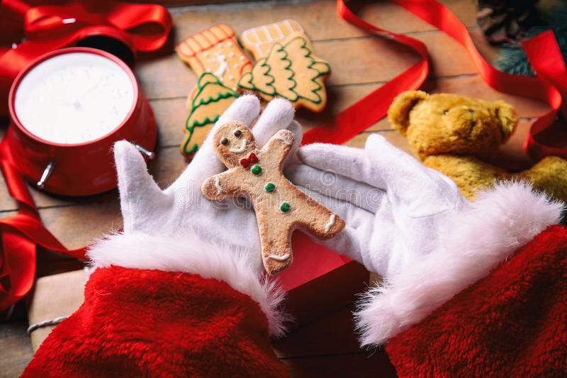 Santa Claus have wrapping a Christmas cookie stock photo