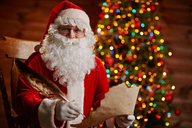 Santa Claus-het schrijven bericht royalty-vrije stock foto's