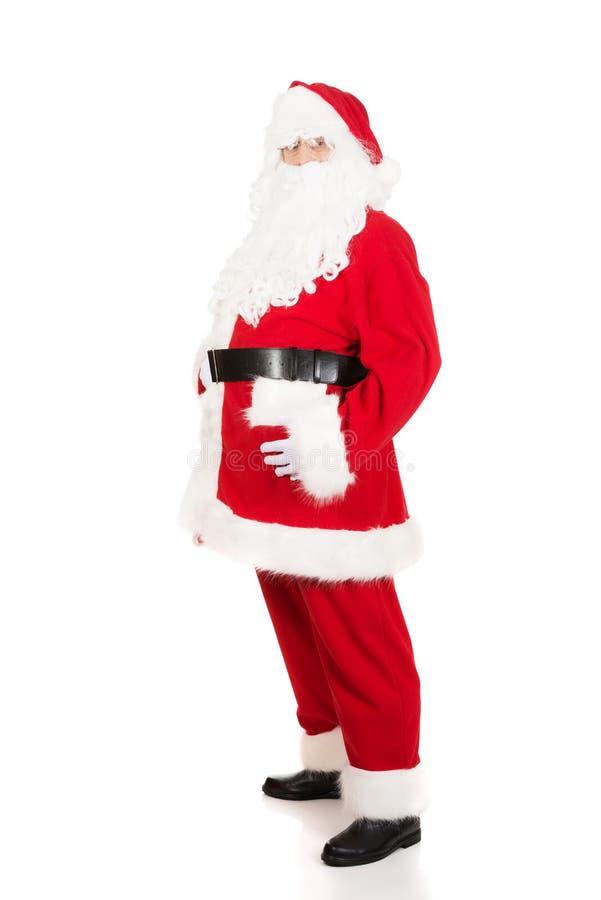 Santa Claus heureuse tenant son gros ventre photo stock