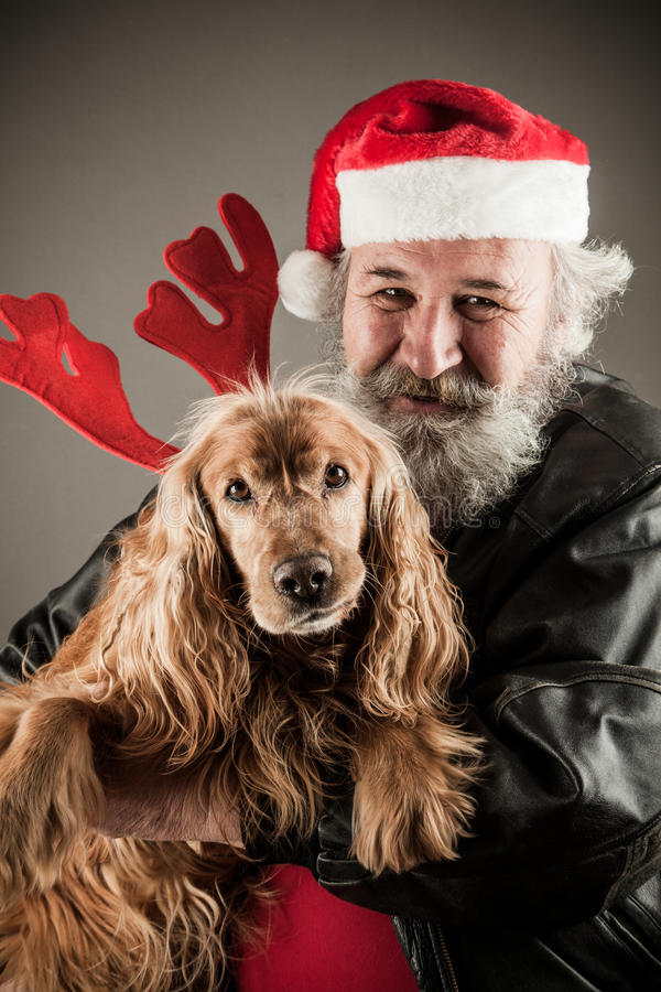Santa Claus with his dog. As Rudolph the Reindeer stock photos