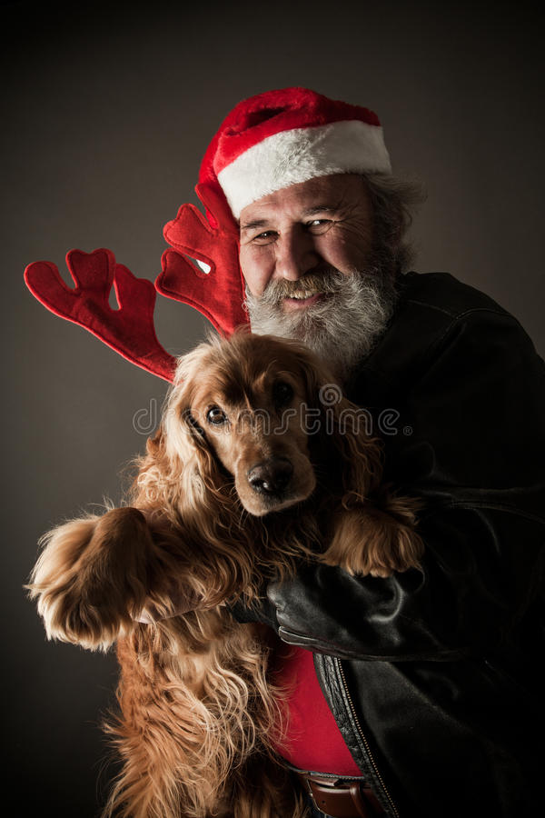 Santa Claus with his dog as Rudolph. The Reindeer stock image