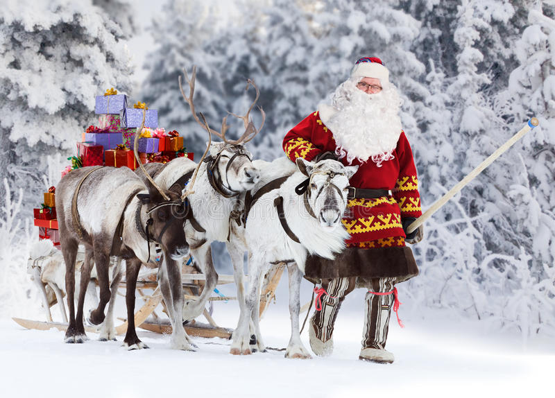 Santa Claus And His Reindeer royalty-vrije stock afbeeldingen