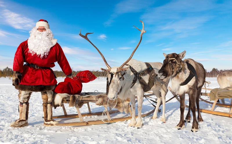Santa Claus And His Reindeer stock foto's