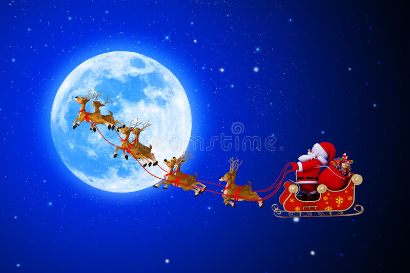 Santa Claus With His Sleigh Very Near To The Moon Royalty Free Stock Image