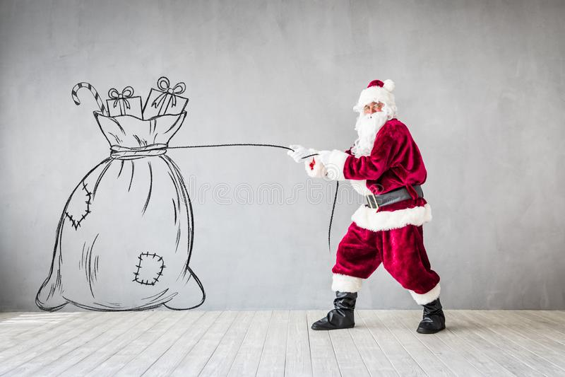 Santa Claus Christmas Xmas Holiday Concept. Santa Claus holding bag. Christmas Xmas holiday concept stock photo