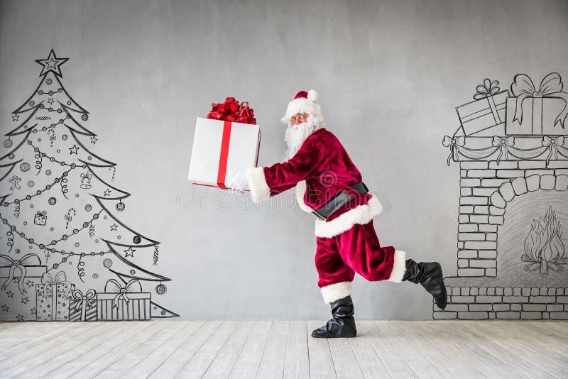 Santa Claus Christmas Xmas Holiday Concept. Santa Claus holding gift box. Christmas Xmas holiday concept stock images