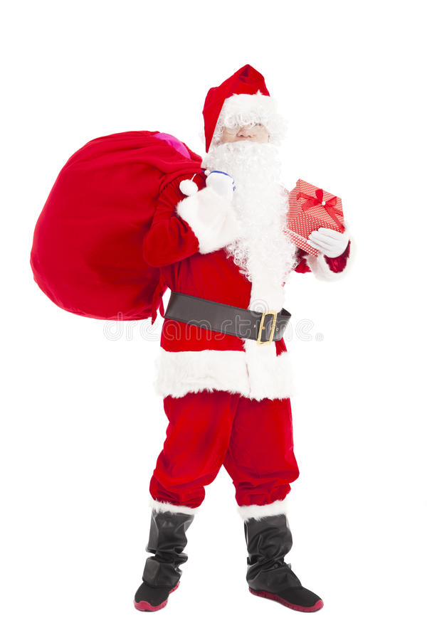 Santa claus holding gift box and gift bag. Isolated royalty free stock image