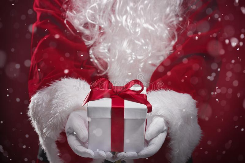 Santa Claus holding gift boxes stock image