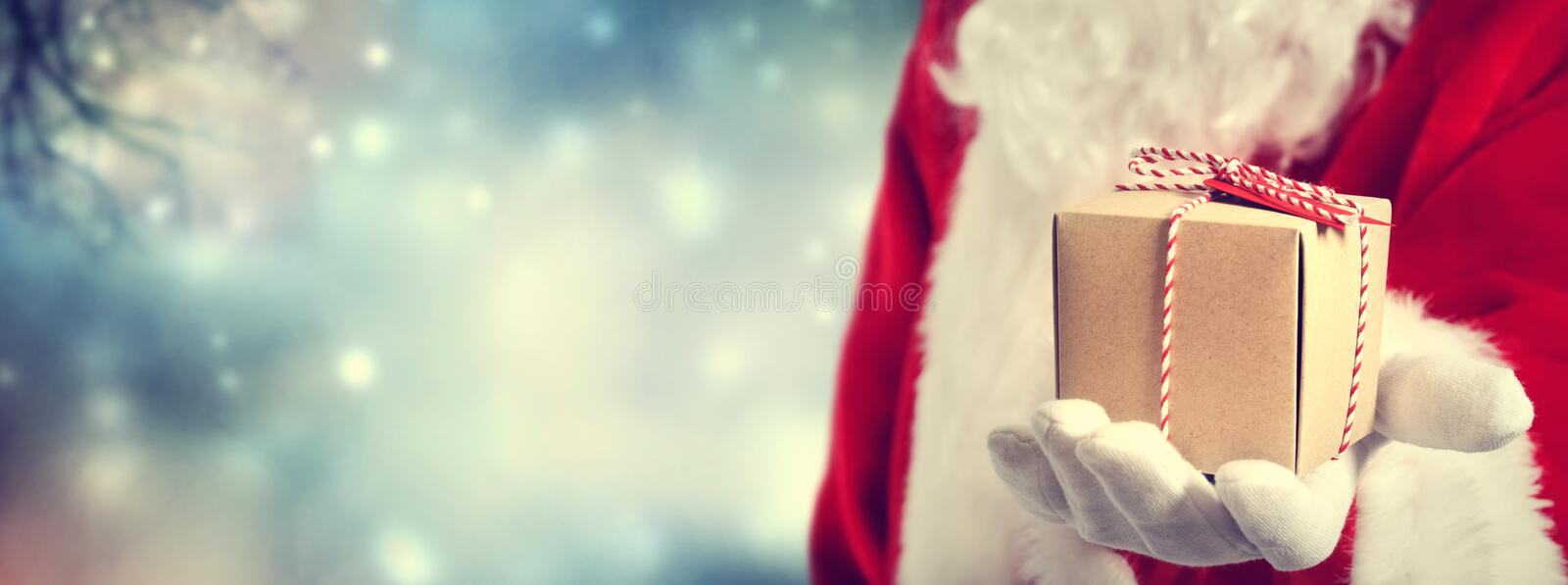 Santa Claus holding gift stock image