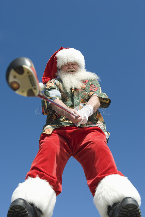 Santa Claus Holding Golf Club stock foto