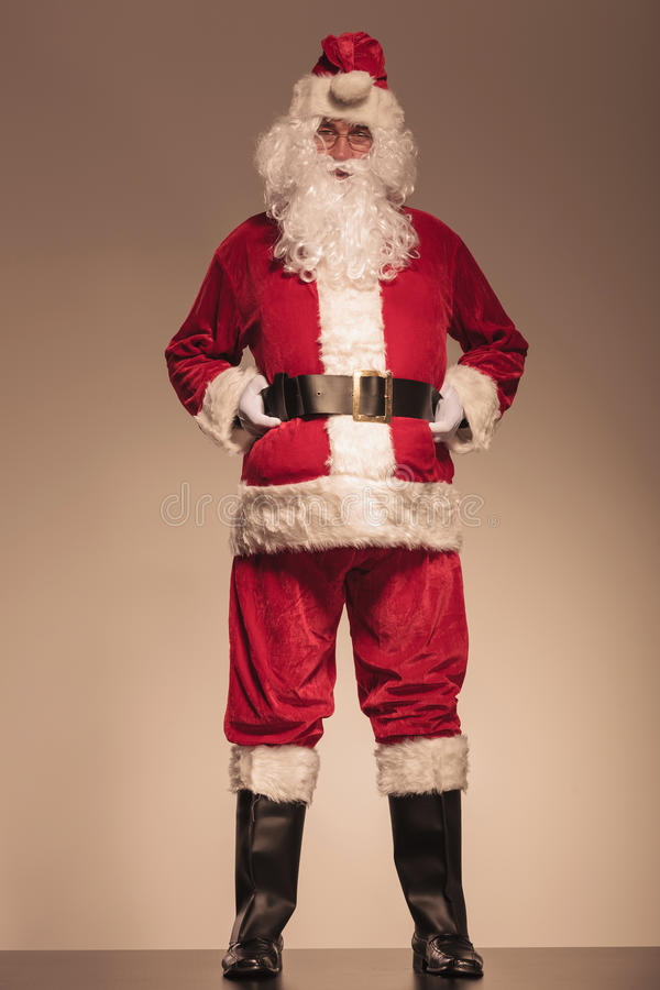 Santa Claus holding his black belt royalty free stock photos