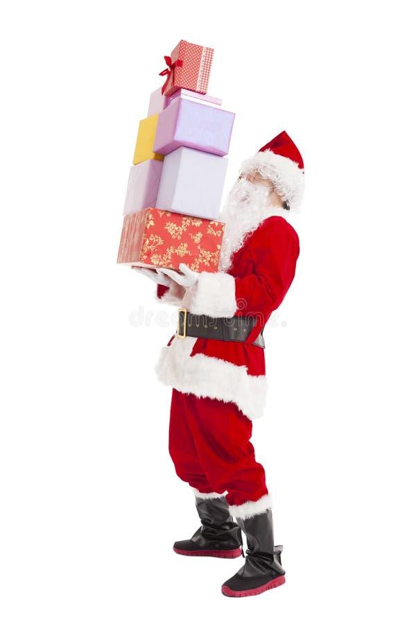 Santa claus holding many gift box. Isolated stock image