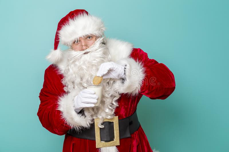 Santa Claus holding milk and cookies royalty free stock photo