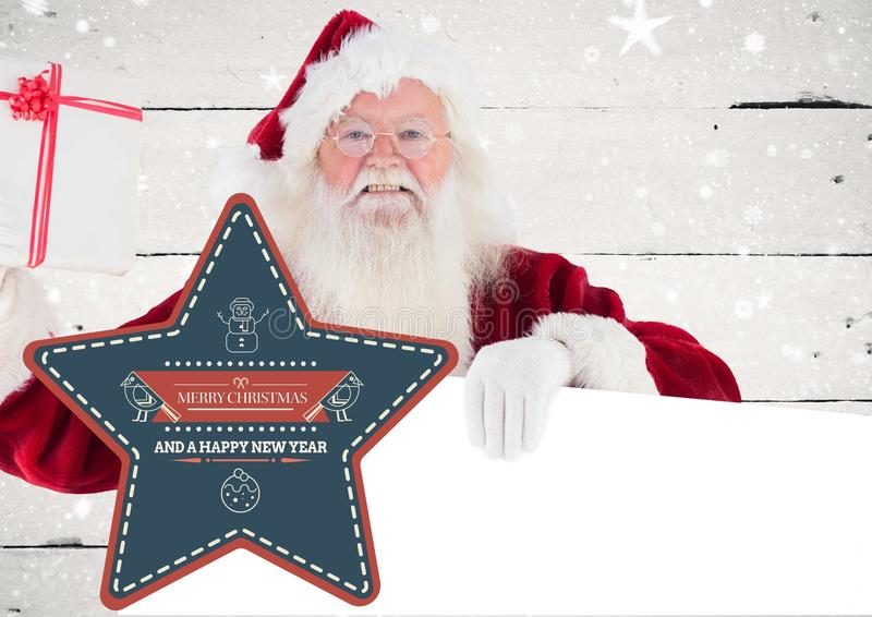 Santa claus holding placard with merry christmas greetings stock photos