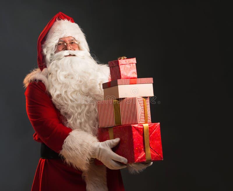 Santa Claus Holding Presents imagens de stock