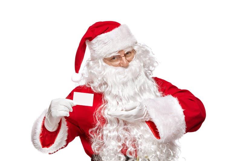 Santa Claus-Holdingvisitenkarte-Nahaufnahmeporträt lokalisiert auf w stockfoto