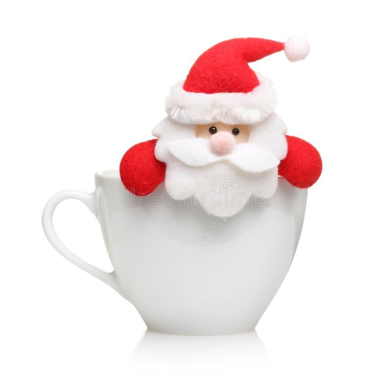Santa Claus i den isolerade koppen royaltyfri fotografi