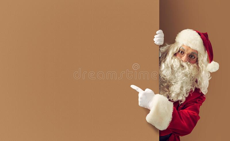 Santa claus indicates a blank space for your text. Santa claus indicates a blank space for your Christmas text stock photo